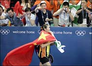 Chinese athlete with flag of China at Athens Olympic games 19-Aug-04