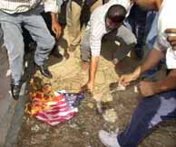 Burning the  American flag in Gaza Strip