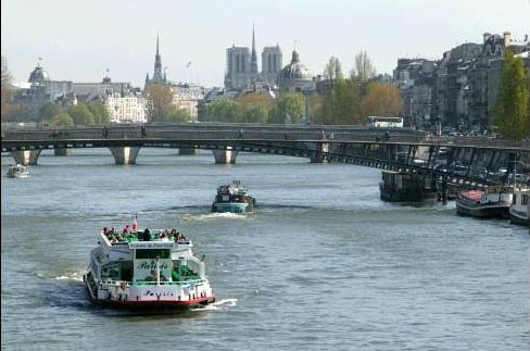 Bateau-mouche and barges on the Seine River, Paris, France Photos - Flags,